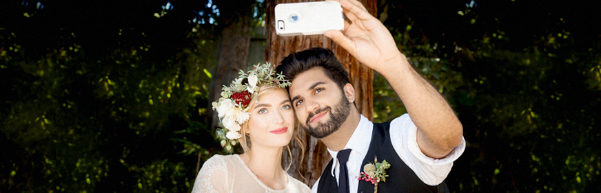 couple-taking-wedding-day-selfie