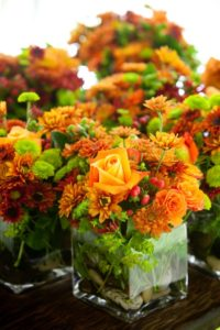 green and orange flowers - wedding table centerpiece