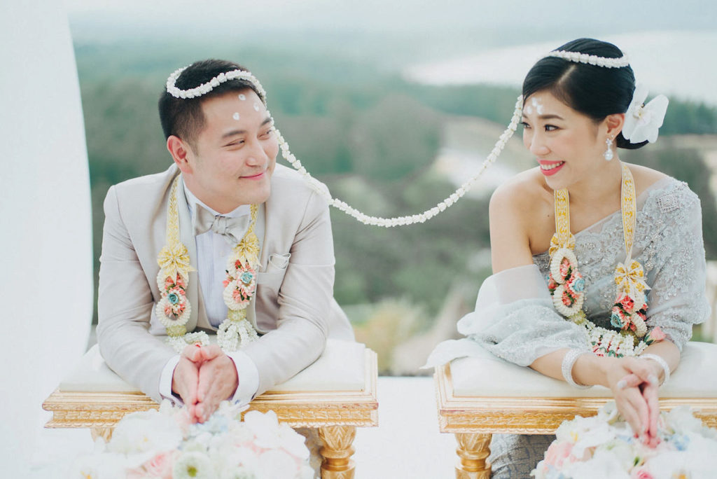 thai couple during sai monkhon ceremony
