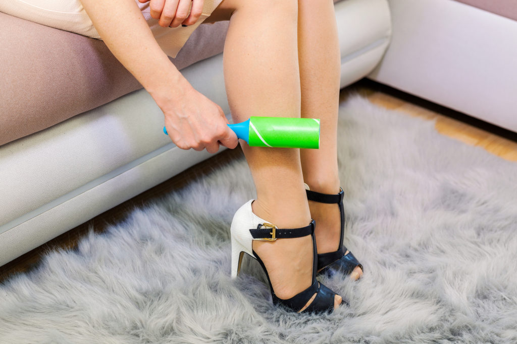 Wedding Day Emergency Kit - Woman In Heels Using Green Lint Roller