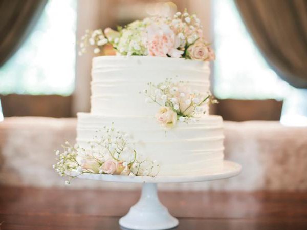 White Wedding Cake With Fresh Flowers And Babys Breath