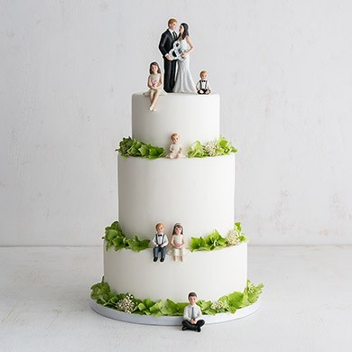 Family With Kids Wedding Cake Toppers On White Cake With Green Trim
