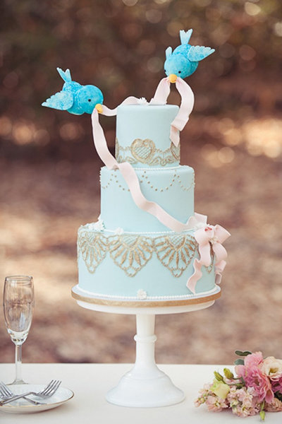 Bluebird Wedding Cake Toppers On Light Blue Cake