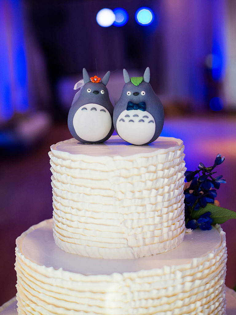 Penguin Wedding Cake Toppers On White Textured Cake