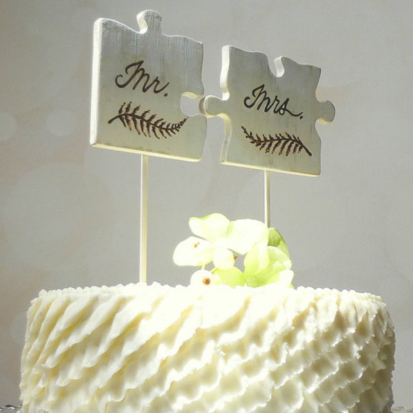 Puzzle Piece Wedding Cake Toppers On White Textured Cake