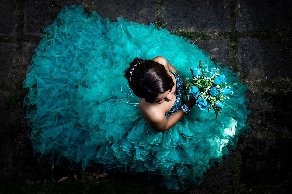 Birds Eye View Of A Teal Quinceanera Dress And Bouquet - Quinceanera Planning