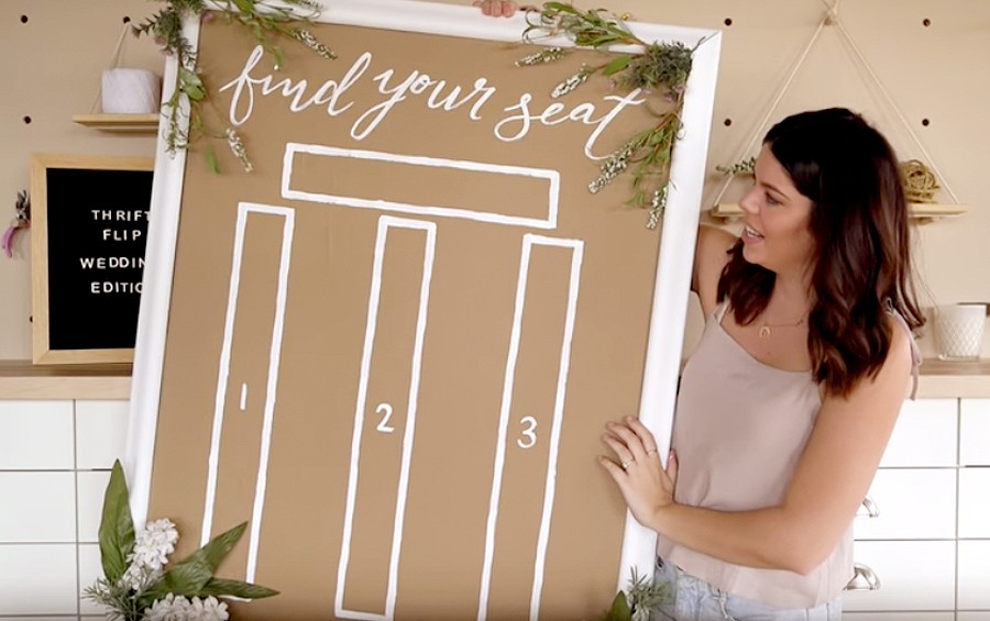 Wedding Hacks - Brunette Woman Holding Up Seating Chart