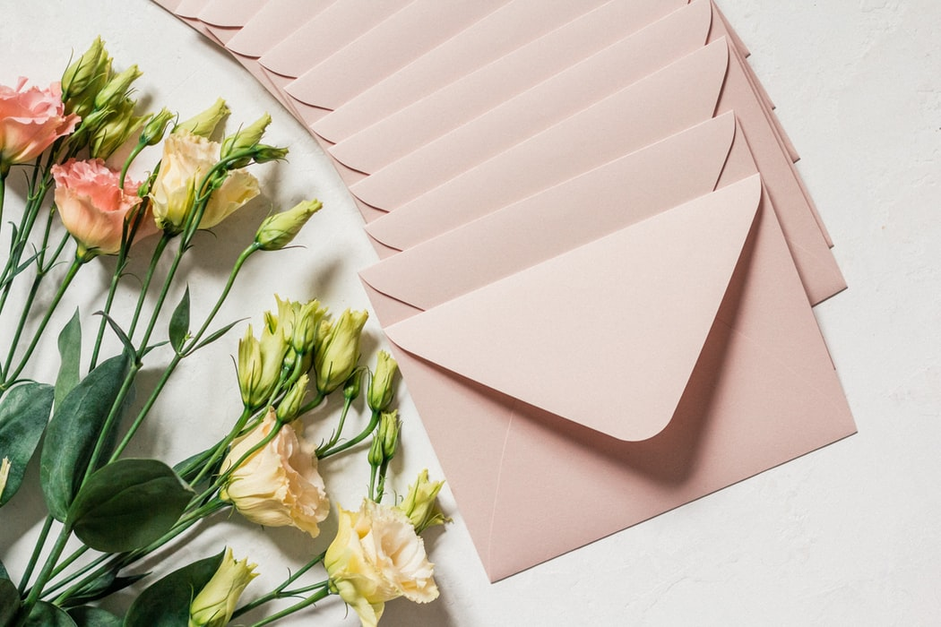 Wedding Invitation Mistakes - Beige Envelopes With Fresh Flowers