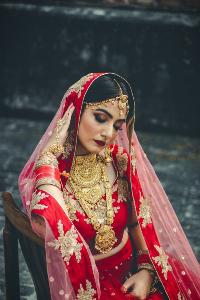 Indian bride wearing red saree.